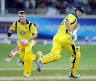 Australian cricketers Shane Watson (R) and David Warner run between wickets during the third and final Twenty20 international cricket match between Australia and Pakistan