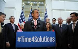 Boehner stands with fellow Republican House leadsrs and addresses reporters in Washington