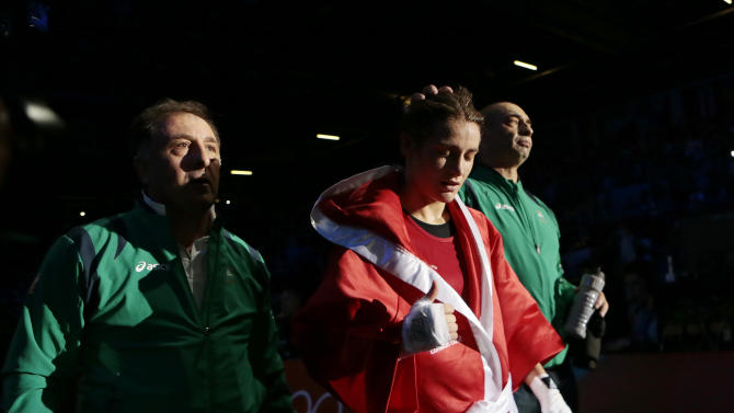 Ireland's Katie Taylor leaves the ring following a fight against Tajikistan's Mavzuna Chorieva in a women's semifinal lightweight 51-kg boxing match at the 2012 Summer Olympics, Wednesday, Aug. 8, 2012, in London. (AP Photo/Ivan Sekretarev)