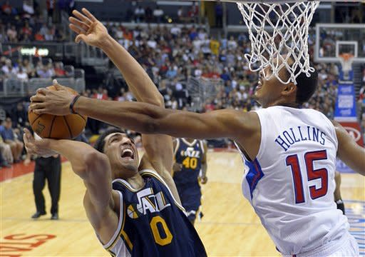 Crawford helps Clippers hold off Jazz 96-94