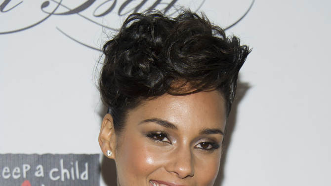 "FILE - This Dec. 6, 2012 file photo shows Alicia Keys at the Keep a Child Alive's ninth annual Black Ball in New York. Keys cut her hair this summer and is now sporting a bob. And she says she ""actually wants to go even shorter"" in an interview last week. The 31-year-old came on the music scene in 2001 with braids, and has mostly worn her hair long. But she says with her new haircut, she's able to do more with her hair.  (Photo by Charles Sykes/Invision/AP)"