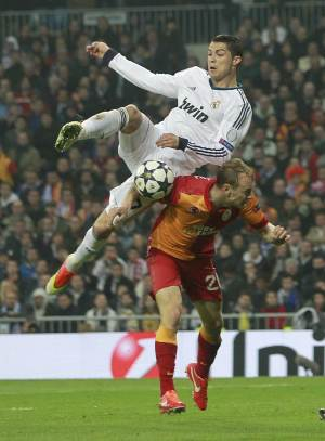 Real Madrid's Cristiano Ronaldo from Portugal, top left, is challenged by Galatasaray's Semih Kaya, right, during the Champions League quarterfinal first leg soccer match between Real Madrid and Galatasaray at the Santiago Bernabeu stadium in Madrid, Wednesday, April 3, 2013. (AP Photo/Andres Kudacki)