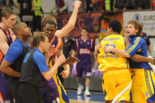 BC Khimki's Egor Vyaltsev (R), Mickeal Gelabale (2nd R) and team mates celebrate winning the Eurocup final basketball match between BC Khimki and Valencia in Khimki, outside Moscow on April 15, 2012.