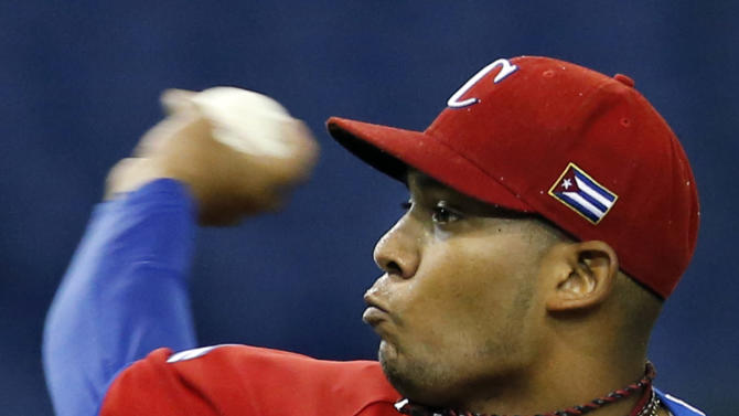 Cuba's starter Vladimir Garcia delivers a pitch against the Netherlands in the first inning of their World Baseball Classic second round game at Tokyo Dome in Tokyo, Monday, March 11, 2013. (AP Photo/Koji Sasahara)