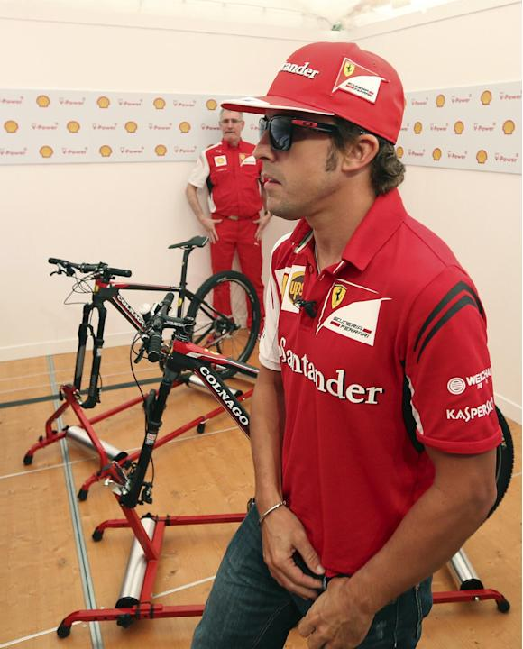Ferrari driver Fernando Alonso of Spain arrives at a publicity event ahead of the Formula One Australian Grand Prix at Albert Park in Melbourne, Australia, Wednesday, March 12, 2014