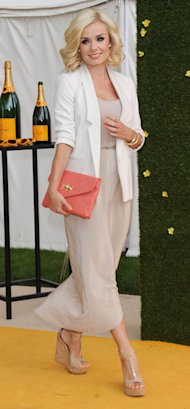Katherine Jenkins is whimsical in white blazer and nude maxi
