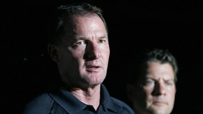 Louisiana State Police Superintendent Col. Mike Edmonson, left, tells reporters of the release of a female hostage as FBI Special Agent in Charge of the New Orleans Division Michael Anderson, right, listens during a nighttime news conference in St. Joseph, La., where a gunman took three people hostage at a Tensas State Bank branch, earlier Tuesday, Aug. 13, 2013. Edmonson announced the release but would not give any other details about the release. (AP Photo/Rogelio V. Solis)