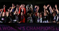 Vfl Wolfsburg's captain Nadine Kessler lifts the trophy as the players celebrates during the Women's UEFA Champions League Final at Stamford Bridge, London.