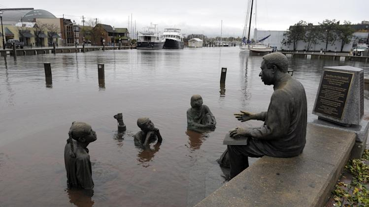 The Kunta Kinte-Alex Haley Memorial sits in flood waters in downtown Annapolis, Md., Tuesday, Oct. 30, 2012, after the superstorm and the remnants of Hurricane Sandy passed through Annapolis. (AP Photo/Susan Walsh)