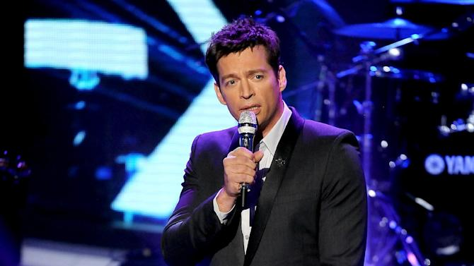 """FILE - This May 2, 2013 file photo released by Fox shows singer Harry Connick Jr. performing onstage at FOX's American Idol Season 12 Top 4 To 3 Live Elimination Show in Los Angeles. Connick Jr. has written a song in honor of a 6-year-old girl killed in the Newtown school shooting. Connick this week released the song """"Love Wins"""" dedicated to Ana Grace Marquez-Greene. He says proceeds will go to the Ana Grace Fund set up to help the girl's family. Connick played with the girl's jazz saxophonist father, Jimmy Greene, and sang at the funeral for Ana, one of 20 first-graders and six adults killed in December at Sandy Hook Elementary School. (AP Photo/Fox, Frank Micelotta)"""