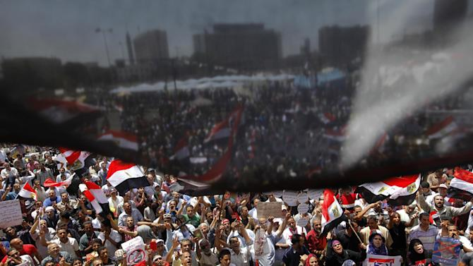 Opponents of Egypt's Islamist President Mohammed Morsi wane national flags as they demonstrate in Tahrir Square in Cairo, Egypt, Friday, June 28, 2013. Thousands of backers and opponents of Egypt's Islamist president held competing rallies in the capital Friday and new clashes erupted between the two sides in the country's second largest city, Alexandria, in a prelude to massive nationwide protests planned by the opposition this weekend demanding Mohammed Morsi's removal.(AP Photo/Amr Nabil)