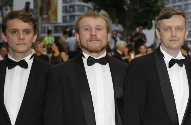 From left, actors Vlad Abashin, Vladimir Svirski and director Sergei Loznitsa arrive for the screening of In The Fog at the 65th international film festival, in Cannes, southern France, Friday, May 25, 2012. (AP Photo/Francois Mori)