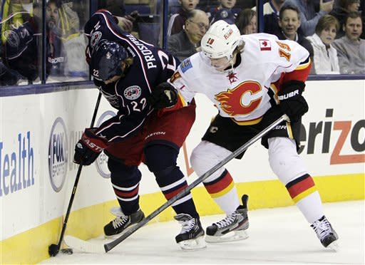 Tanguay's OT goal wins it for Flames, 4-3
