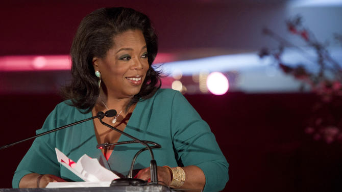 FILE-In this Friday, March 9, 2012, file photo, Oprah Winfrey accepts her DVF Lifetime Leadership Award at The Third Annual DVF Awards held at the United Nations in New York. Winfrey, 58, has a net worth of $2.7 billion, and is ranked No. 151 on Forbes' 2012 400 list. The nation's only African-American billionaire, Oprah Winfrey came from meager beginnings to build a television empire with massive influence on what people around the globe read, eat and think.  (AP Photo/Charles Sykes, File)