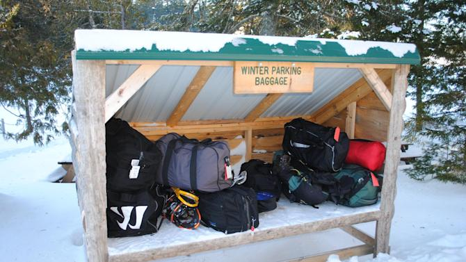 This December 2012 photo shows a small shed where luggage is left for pickup by guests at the Appalachian Mountain Club's Gorman Chairback Lodge, a backcountry wilderness lodge near Greenville, Maine. In winter, visitors can reach the lodges and cabins only by cross-country skiing in but AMC staff will transport one piece of luggage per guest by snowmobile from town to the lodge.  (AP Photo/Lynn Dombek)