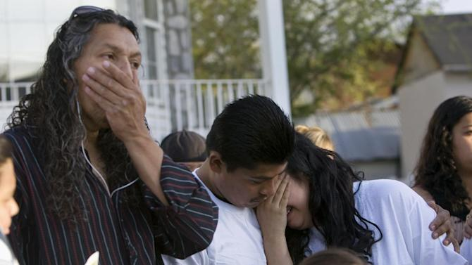 Antonio Lopez, from left, with Juan Munoz, and Johana Portillo-Lopez, daughter of Ricardo Portillo, who died after injuries following an assault by a soccer player on April 27, becomes emotional after a news conference discussing Portillo's death, Sunday, May 5, 2013, in Salt Lake City. Police have accused a 17-year-old player in an April 27 recreational soccer league game of punching Portillo after he called a foul on him and issued him a yellow card. Portillo died Saturday after a week in a coma. (AP Photo/The Salt Lake Tribune, Kim Raff) DESERET NEWS OUT; LOCAL TV OUT; MAGS OUT.