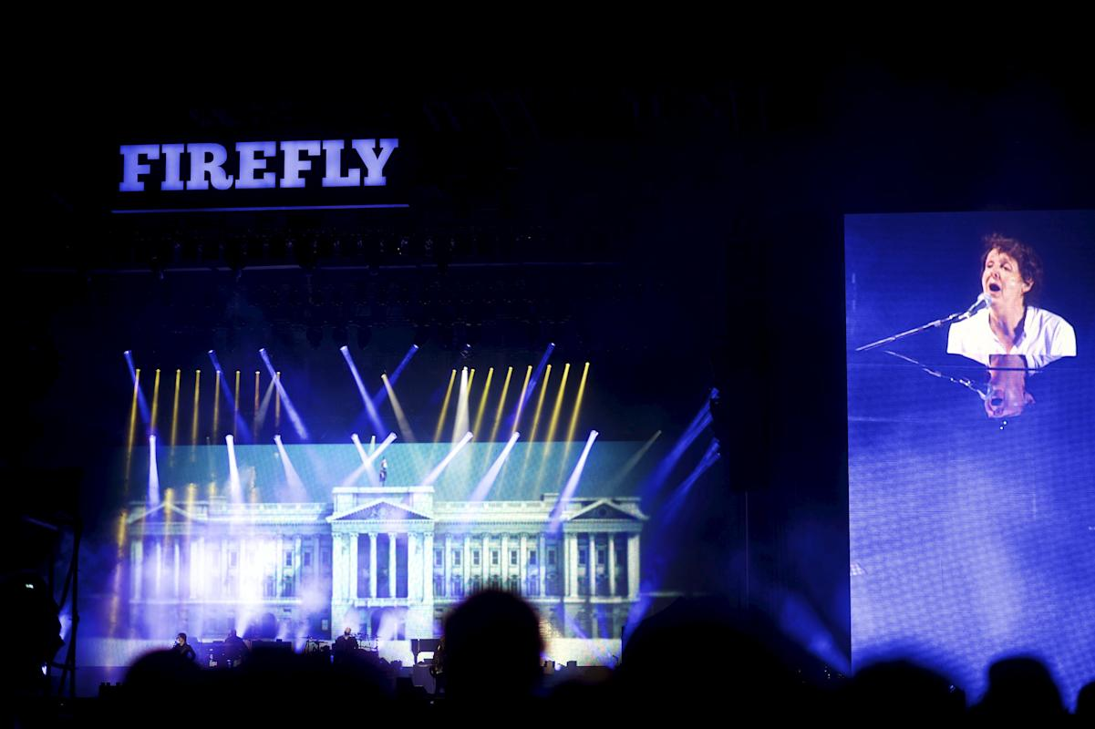 Paul McCartney's performance is projected on large screens during the Firefly Music Festival in Dover
