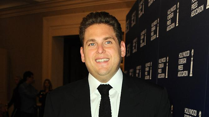 "FILE - This Aug. 13, 2013 file photo shows actor Jonah Hill at the Hollywood Foreign Press Luncheon at the Beverly Hilton Hotel in Beverly Hills, Calif. Hill and Kristen Bell are among a batch of celebrities donning Russian-language ""Love Conquers Hate"" T-shirts to show support for gays in Russia alarmed by a new law banning pro-gay ""propaganda."" (Photo by Jordan Strauss/Invision/AP, File)"