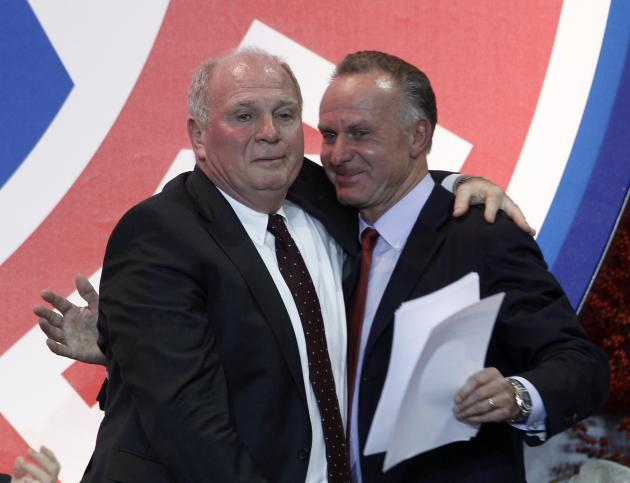 Bayern Munich's President Hoeness hugs CEO Rummenigge during annual meeting of German Bundesliga first division soccer club in Munich