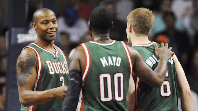 Milwaukee Bucks' Caron Butler (3) laughs with teammates O.J. Mayo (00) and Nate Wolters (6) during the Bucks' preseason NBA basketball game against the Minnesota Timberwolves on Thursday, Oct. 10, 2013, in Sioux Falls, S.D