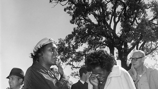 FILE - In this Nov. 22, 1963 file photo, women burst into tears outside Parkland Hospital upon hearing that President John F. Kennedy died from the shooting by an assassin while riding in a motorcade in Dallas. Looking at why so many black people revered him then - and why younger generations have largely forgotten his civil rights work now - shows that even 50 years later, Kennedy holds a complicated but pivotal place in black history. (AP Photo/File)