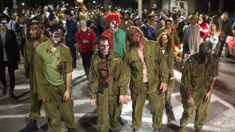 "Israelis costumed as zombie soldiers take part in annual ""Zombie Walk"" for Jewish holiday of Purim in Tel Aviv"