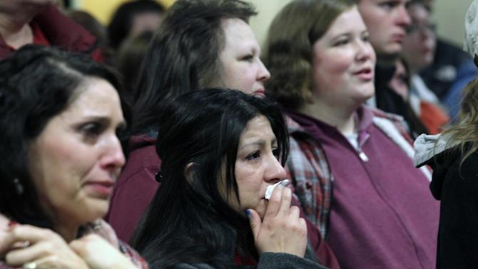 """Family members and friends of a 6-year-old Emilie Parker, killed in last week's Connecticut school shooting, look on during a memorial service Thursday, Dec. 20, 2012, at the Ben Lomond High School, in Ogden, Utah. Family members who brought blond-haired Emilie Parker back to Utah for her burial remembered the 6-year-old killed in the Connecticut school shooting as a """"picture of perfection"""" at a memorial service Thursday in Ogden. (AP Photo/Rick Bowmer)"""