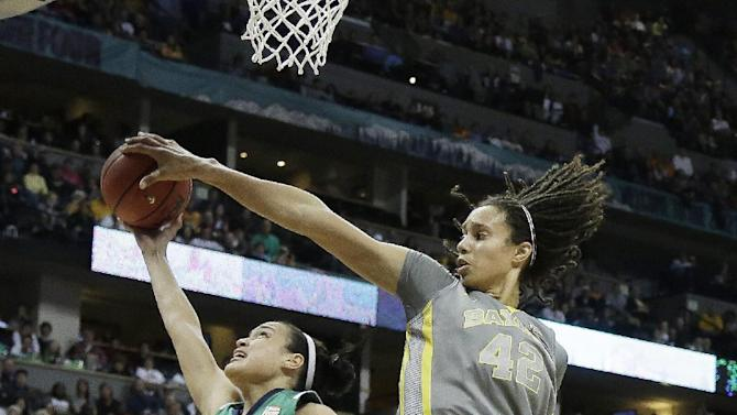 Baylor center Brittney Griner (42) blocks a shot by Notre Dame guard Kayla McBride (23) as Notre Dame forward Markisha Wright (34) watches during the first half in the NCAA women's Final Four college basketball championship game, in Denver, Tuesday, April 3, 2012.  (AP Photo/Julie Jacobson)