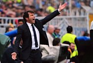 Juventus&#39; coach Antonio Conte reacts during the Serie A match Novara against Juventus on April 29, at the Novara stadium. Antonio Conte believes should Juventus win this season&#39;s scudetto crown it would be as great a shock as when Verona won the 1985 Serie A title