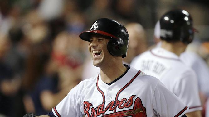 Atlanta Braves starting pitcher Tim Hudson smiles after hitting a home run in the fifth inning of a baseball game against the Washington Nationals on Tuesday, April 30, 2013, in Atlanta. (AP Photo/John Bazemore)