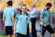 Spanish midfielder Andres Iniesta (C) is pictured during a training session at the Olympic Stadium in Kiev, on the eve of the team's Euro 2012 football championships final match. Amid all the surprising criticism that they have attracted during Euro 2012, finalists Spain can at least reflect happily on the universal admiration shown for Iniesta