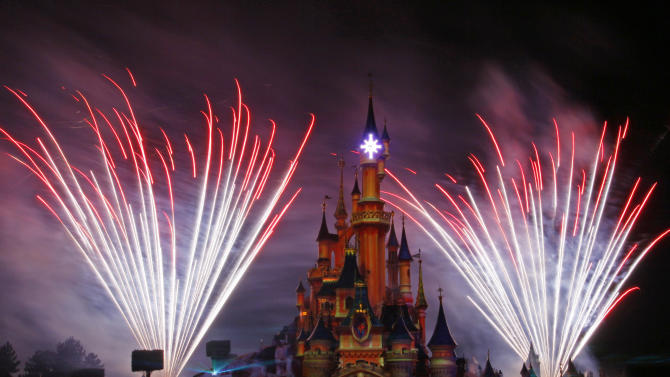 A firework display lights up the castle of Sleeping Beauty in Disneylands theme park in Marne-la-Vallee, east of Paris, Saturday March 31, 2012. This will mark the 20th year since Disneyland opened in Paris in 1992.(AP Photo/Michel Spingler)