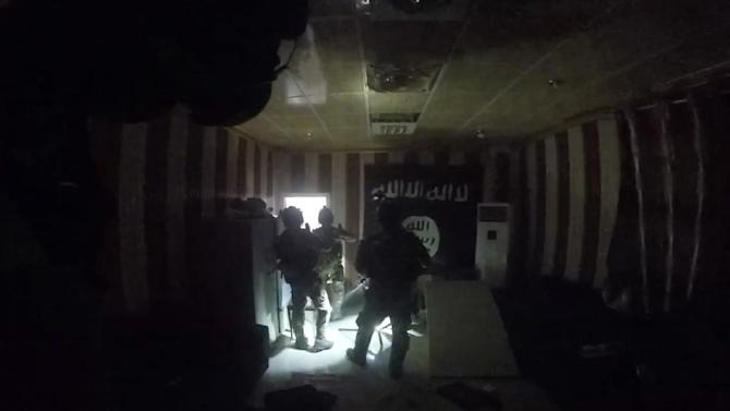An image taken from video released by the Kurdistan Region Security Council on October 25, 2015 purportedly shows a raid by Kurdish forces supported by US Delta Force fighters in which they reportedly freed some 70 hostages