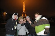 <p>People celebrate New Year's Even with champagne near the Eiffel Tower in Paris last year. ne of the world's oldest shared traditions, New Year's celebrations take many forms, but most cultures have one thing in common -- letting one's hair down after a long, hard year.</p>