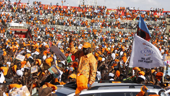 Orange Democratic Movement (ODM) Presidential candidate and current Prime Minister Raila Odinga waves to the crowd from a vehicle during a campaign rally at Nyayo National Stadium, Nairobi, Kenya, Saturday, March 2, 2013. Kenya's top two presidential candidates - Uhuru Kenyatta and Raila Odinga - held their final rallies Saturday before large and raucous crowds ahead of Monday's vote, which is the first nationwide election since Kenya's December 2007 vote descended into tribe-on-tribe violence that killed more than 1,000 people. (AP Photo/Khalil Senosi)