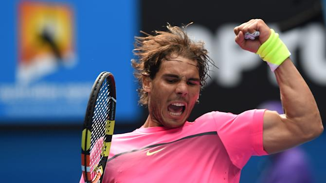 Spain's Rafael Nadal celebrates after victory in his men's singles match against South Africa's Kevin Anderson at the Australian Open tennis tournament in Melbourne on January 25, 2015
