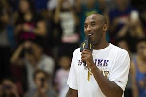 Kobe speaks to fans while attending a youth basketball final match in Hong Kong