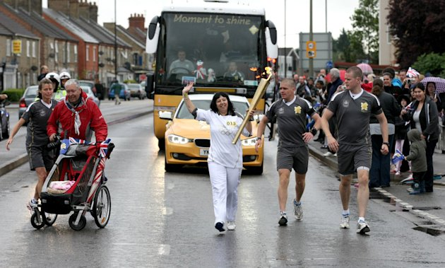 Day 47 - The Olympic Torch Continues Its Journey Around The UK