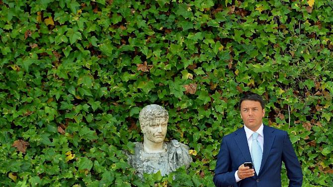 Italian Prime Minister Matteo Renzi waits for the arrival of EU Commission President Jose Manuel Barroso in Rome's Villa Madama on July 4, 2014