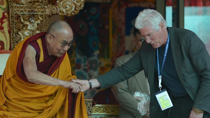 US actor Richard Gere (right) with the Dalai Lama to greet him on his 79th birthday at Choglamsar, about 10 km from Leh, Ladakh on July 6, 2014