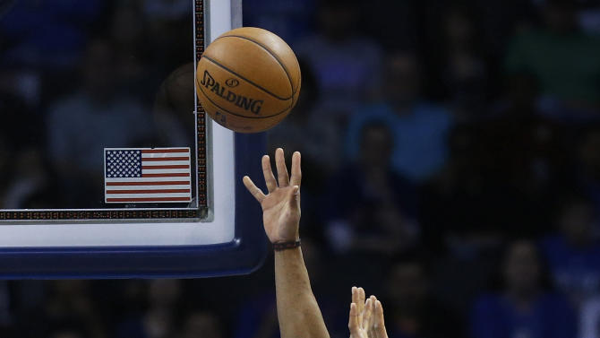 Oklahoma City Thunder guard Russell Westbrook (0) is fouled by New York Knicks center Tyson Chandler (6) while shooting in the first quarter of an NBA basketball game in Oklahoma City, Sunday, April 7, 2013. (AP Photo/Sue Ogrocki)
