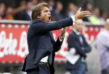 Juventus' coach Conte gestures during their Italian Serie A soccer match against Inter Milan in Milan