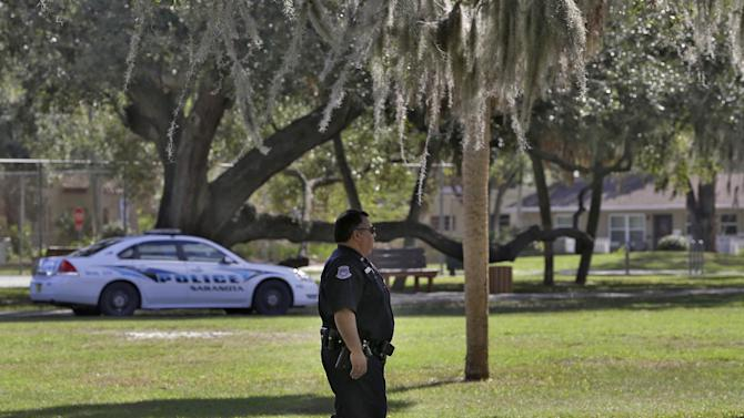 In a Friday, Jan. 11, 2013 photo, Sarasota Police Officers patrol Gillespie Park in Sarasota, Fla. Law enforcement officials have stepped up patrols at the park to keep the homeless away. Newer, wealthy residents in the Gulf Coast city known for its arts scene and beautiful beaches are buying expensive downtown condos so they can live an urban lifestyle, but don't want the problems associated with a city, including the 700 or so homeless people who inhabit the county, the American Civil Liberties Union and others contend. (AP Photo/Chris O'Meara)