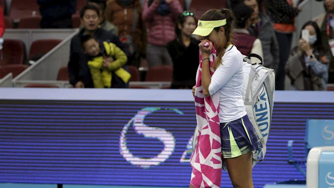 Ivanovic leaves after losing to Bacsinszky at the China Open tennis tournament in Beijing