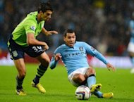 Aston Villa's USA defender Eric Lichaj (L) vies with Manchester City's Argentinian forward Carlos Tevez during the League Cup third round football match between Manchester City and Aston Villa at The Etihad stadium in Manchester. Manchester City suffered a surprise exit from the League Cup as Aston Villa clinched a 4-2 third round win