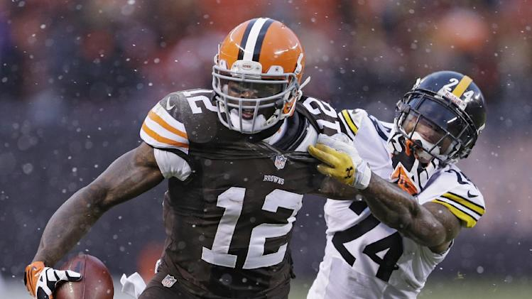 Cleveland Browns wide receiver Josh Gordon (12) is tackled by Pittsburgh Steelers cornerback Ike Taylor (24) after a catch in the fourth quarter of an NFL football game Sunday, Nov. 24, 2013, in Cleveland. The Steelers won 27-11
