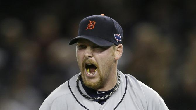 Detroit Tigers' Phil Coke reacts after striking out New York Yankees' Curtis Granderson to end Game 2 of the American League championship series Sunday, Oct. 14, 2012, in New York. The Tigers defeated the Yankees 3-0.  (AP Photo/Matt Slocum)
