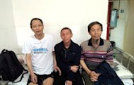 This picture released by China Human Rights Defenders shows Li Wangyang (left) with his friends in Shaoyang, Hunan province. Li -- a leading Chinese dissident who was jailed for more than 22 years after the 1989 Tiananmen democracy protests -- has died in strange circumstances in central China, his family and rights groups told AFP