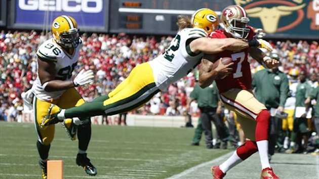 Green Bay Packers linebacker Clay Matthews (52) commits a late hit on San Francisco 49ers quarterback Colin Kaepernick (7) (Reuters)