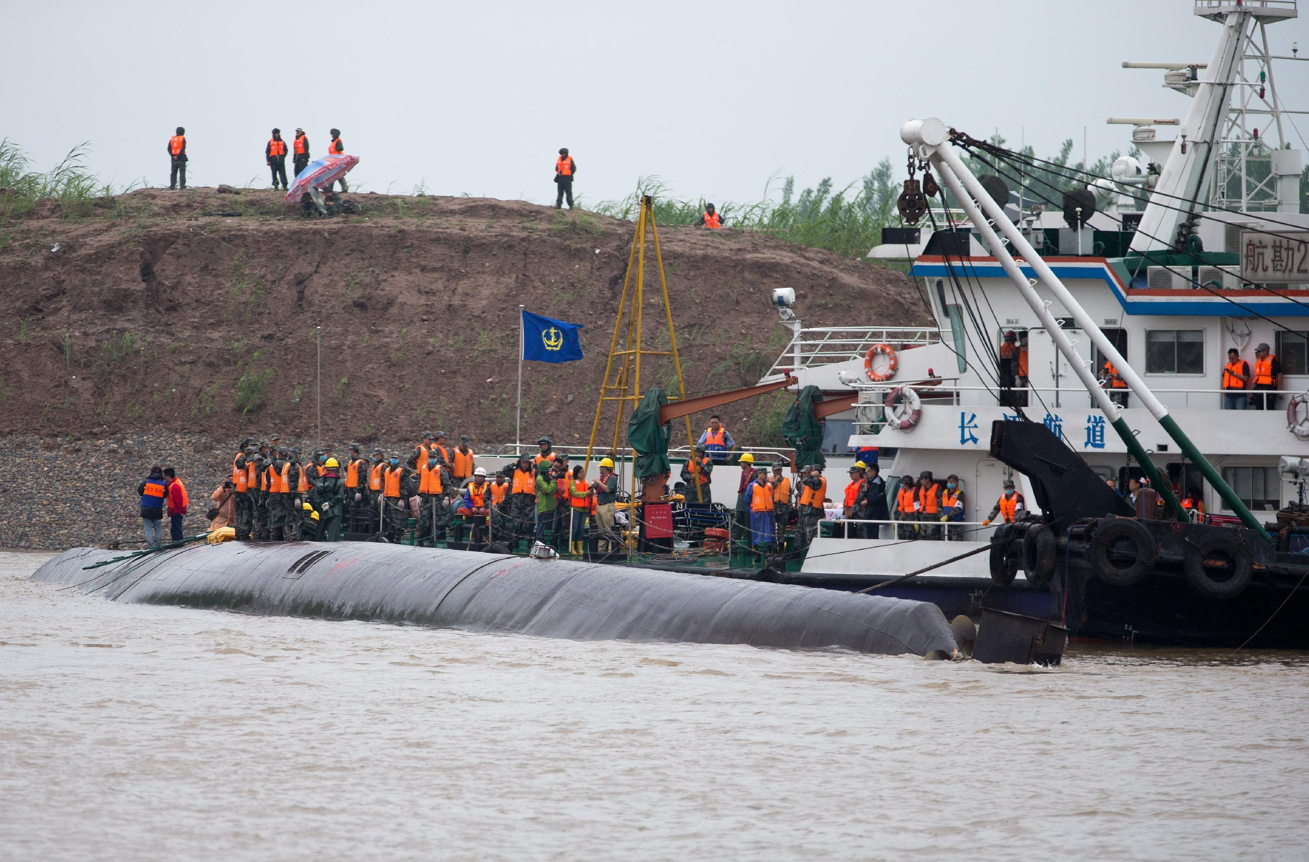The Latest on China Boat Sinking: Ship cited for violations